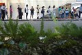 Hong Kong residents queue for their vaccine doses at Lai Chi Kok Park Sports Centre on June 16. Photo: Winson Wong