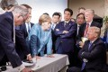 Angela Merkel talks to then US president Donald Trump, surrounded by other G7 leaders, during a summit in La Malbaie, Quebec, Canada, on June 9, 2018. The photo went viral on social media, spawning a plethora of memes. Photo: AFP/Bundesregierung
