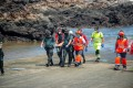 Emergency workers and Civil Guard staff retrieve the lifeless body of a minor in Orzola, Lanzarote, Canary Islands, Spain on Friday. Photo: EPA-EFE