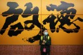 A young passenger at the new Kai Tak MTR station stands against a wall that is splashed with Abe Au's calligraphic work depicting the area's name. Photo: Winson Wong