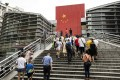 People walk up the steps at a border crossing facility, at the Sha Tou Jiao Port, in Shenzhen. Photo: Bloomberg