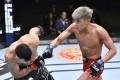 Choi Seung-woo punches Julian Erosa in their featherweight bout at UFC Vegas 29. Photo: Chris Unger/Zuffa LLC