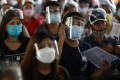 People wait to get inoculated with the Pfizer vaccine in Caloocan City, Metro Manila. Photo: EPA-EFE