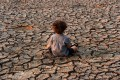 A child sits in a drought-affected area in the southern outskirts of Tegucigalpa city in Honduras on April 22, 2016. For our children and grandchildren, the horrors of climate change will be all too evident. Photo: AFP