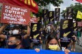 Filipino protesters hold placards during a rally outside the Chinese consular office in Manila on July 12. The demonstration marked the fifth anniversary of the country's victory at the Permanent Court of Arbitration in favour of the Philippines' claims in the South China Sea. Photo: EPA-EFE