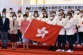 Hong Kong's Chief Executive Carrie Lam Cheng Yuet-ngor (in pink blouse, first row) and sports chief Timothy Fok Tsun-ting (first row, third right)  pose with members of the Hong Kong delegation during a flag presentation ceremony for the Tokyo Olympic Games, at Government House on July 8. Photo: Xinhua