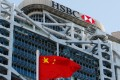 A Chinese flag flies in front of HSBC's headquarters in Hong Kong. Photo: Reuters