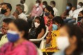 People in Bangalore, India, attend an event on July 25 disbursing scholarships to children who lost their parents to Covid-19. Photo: EPA-EFE