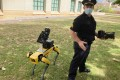 The Honolulu police demonstrate a robotic dog. Police departments say the canine bots are used like drones or other robots to keep humans safe. Photo: AP/Jennifer Sinco Kelleher