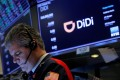 A trader works during the IPO for Didi Global Inc on the New York Stock Exchange floor in New York City on June 30. China's cyberspace agency said it had launched an investigation into the Chinese ride-hailing giant to protect national security and the public interest, two days after it began trading on the NYSE. Photo: Reuters