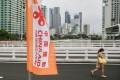 A woman walks across the China-funded Estrella-Pantaleon Bridge in Makati City, the Philippines, on July 29. Photo: Xinhua