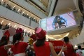 People watch track cyclist Sarah Lee Wai-sze in Olympic action at APM mall in Kwun Tong. Photo: Winson Wong