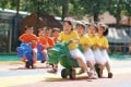 Children race against each other at a kindergarten in Neiqiu county, Xingtai, Hebei province on June 10. China's antitrust actions reflect its socialist views, where opportunity should be equal to all. Photo: Xinhua