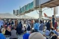 Afghans crowd the tarmac at Kabul airport on Monday as they seek to flee the country after the Taliban took control. Photo: AFP