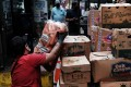 A worker unloads food in the Queens borough of New York City on June 4. Average wage-earners' salaries have failed to keep up with inflation. Photo: AFP