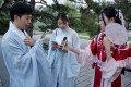 Young people dressed in hanfu use their mobile devices at an event marking the traditional Qixi festival, the Chinese equivalent of Valentine's Day, at a park in Beijing. Photo: Reuters