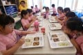 Students enjoy their lunch at a school in in Tsing Yi in May 2016. The current half-day arrangement at most schools in Hong Kong is meant to reduce the chances of Covid-19 spreading. Photo: David Wong