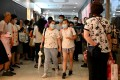 Students and parents come away from a tutoring centre in Beijing's Haidian district on July 29. China's crackdown on after-school tutoring has affected the market value of education companies. Photo: AFP