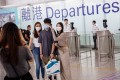 Friends and relatives take photos before boarding a London-bound flight at Hong Kong airport on August 8. Photo: EPA-EFE