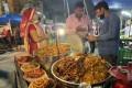 A pickle seller at a street market in India. Photo: Rakesh Kumar