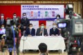 Thirteen educators, including (front, from the left) Ho Hon-kuen, Chiu Cheung-ki and Wong Kam-leung, hold a press conference at Causeway Bay Victoria Kindergarten & International Nursery on August 9 before they submit their applications to contest the Election Committee education subsector election. Photo: Nora Tam