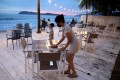 Esther Lee, owner of the Hidden Langkawi restaurant, cleans a table at her restaurant as Langkawi gets ready to open to domestic tourists from September 16. Photo: Reuters