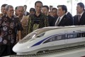 Indonesian President Joko Widodo looks at a model of a high-speed train which will connect Jakarta to Bandung. File photo: AP