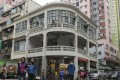 The three-storey building in Sham Shui Po has a curved facade that wraps around the angle of the street with a loggia on the first floor overhanging the pavement. Photo: K.Y. Cheng