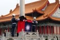 Soldiers hoist Taiwan's national flag at the Liberty Square in Taipei, Taiwan, on Wednesday. Beiijng regards Taiwan as a breakaway province that must be reunited with the mainland. Photo: EPA-EFE