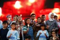 Family members hold candles during the fifth annual remembrance event for missing Malaysia Airlines flight MH370, in Kuala Lumpur, Malaysia on March 3. Photo: Reuters