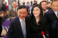 Thaksin and Yingluck Shinawatra at an event in Tokyo in March last year. Photo: AFP