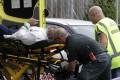 Ambulance staff attend to a victim. Photo: AP