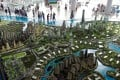 Potential buyers look at a model of Country Gardens' Forest City project in Johor, Malaysia. Photo: Reuters