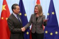 Chinese Foreign Minister Wang Yi is welcomed by EU foreign policy chief Federica Mogherini ahead of a meeting in Brussels. Photo: Reuters