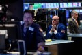 Traders work ahead of the closing bell on the floor of the New York Stock Exchange on March 18, on a day when stocks finished higher thanks to gains from petroleum companies and banks. Photo: AFP
