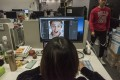 At Megvii offices in Beijing, a designer prepares marketing material for a facial-recognition product. The company's marketing manager has said Megvii's Face program has helped police make thousands of arrests. Photo: The Washington Post
