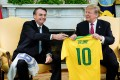 Brazil's President Jair Bolsonaro presents a Brazil national soccer team jersey to US President Donald Trump. Photo: Reuters
