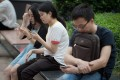 These young smartphone users in Shenzhen are unlikely to have access to all the news websites or social media apps available in Hong Kong. Photo: AFP