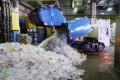 Plastic bottles pile up at a collection facility in Tokyo. Photo: Kyodo