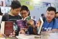 Youngsters check out English thrillers at the Hong Kong Book Fair in July 2017. Photo: Sam Tsang