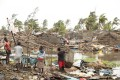 People trying to salvage what is left of their homes in cyclone-hit Mozambique. Photo: EPA-EFE