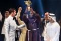 Kenyan teacher Peter Tabichi (C) holding up the Global Teacher Prize (GTP) trophy. Photo: AFP