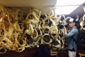 Rob Stewart photographs a collection of shark jaws in a sports fisherman's home for his documentary Sharkwater Extinction.