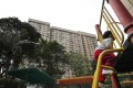 A child plays in front of Oi Wo House in an estate under the Tenants Purchase Scheme in Tai Wo on January 4. By promoting home ownership, the scheme has also facilitated family stability. Photo: Winson Wong