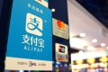 Signage support the use of Ant Financial Service Group's Alipay smartphone-enabled payment platform, along side MasterCard and China UnionPay in Hong Kong. Photo: SCMP