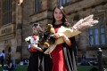Chinese-born students pose for family photos after graduating from Sydney University, in October 2017. Photo: AFP
