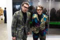 Christopher Makos (left) and Paul Solberg, known as The Hilton Brothers, in custom-made suits at Art Basel Hong Kong.