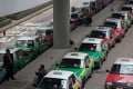 Taxis parked in front of the Legislative Council, as a drivers' alliance demands a ban on Uber for threatening their livelihood, in March 2018. Photo: EPA-EFE