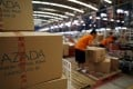 Employees at online retailer Lazada fill orders at the company's warehouse in Jakarta, Indonesia. Photo: Reuters