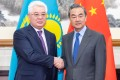 Chinese Foreign Minister Wang Yi and his Kazakh counterpart Beibut Atamkulov meet in Beijing. Photo: Xinhua